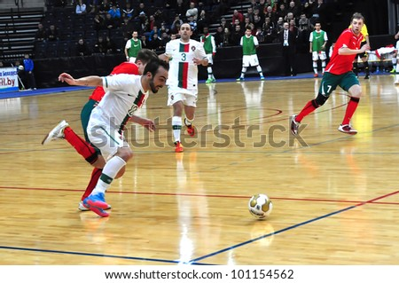MINSK, BELARUS - MARCH 26: qualification World Cup 2012, Belarus � Portugal: Ricardinho (with ball) rushes to the belarussian gate on March 26, 2012 in Minsk, Belarus - stock photo