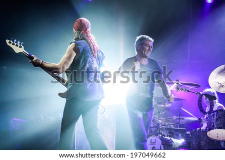 MINSK, BELARUS - MARCH 27, 2011: The famous rock band Deep Purple performs on stage during thier concert in Minsk, Belarus on March 27, 2011 - stock photo