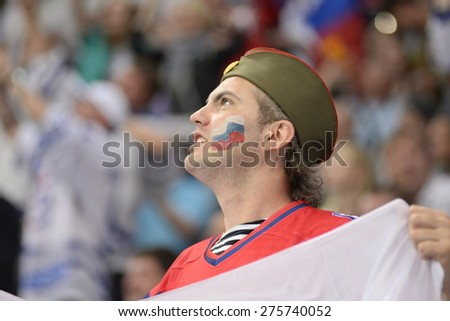 MINSK, BELARUS - MAY 20: Fan of Russia and Belarus during 2014 IIHF World Ice Hockey Championship match at Minsk Arena on May 20, 2014 in Minsk, Belarus. - stock photo