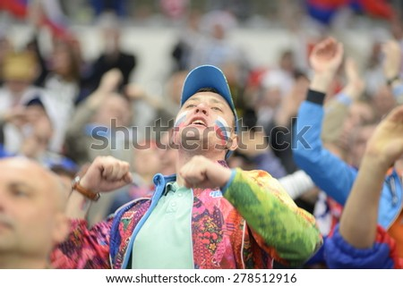 MINSK, BELARUS - MAY 12: Fan of Russia during 2014 IIHF World Ice Hockey Championship match at Minsk Arena on May 12, 2014 in Minsk, Belarus. - stock photo