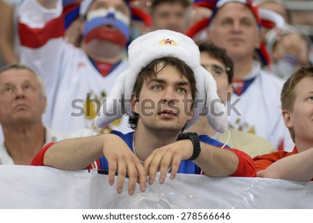 MINSK, BELARUS - MAY 24: Fan of Russia during 2014 IIHF World Ice Hockey Championship match at Minsk Arena on May 24, 2014 in Minsk, Belarus. - stock photo