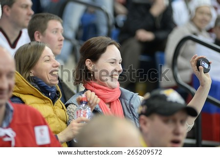 MINSK, BELARUS - MAY 17: Fan of Russia  show puck during 2014 IIHF World Ice Hockey Championship match at Minsk Arena on May 17, 2014 in Minsk, Belarus. - stock photo