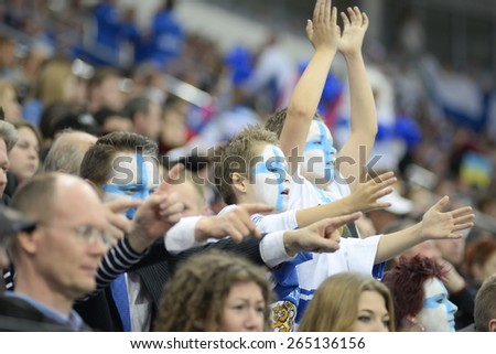 MINSK, BELARUS - MAY 16: Fans of Finland celebrate during 2014 IIHF World Ice Hockey Championship match at Minsk Arena on May 16, 2014 in Minsk, Belarus. - stock photo
