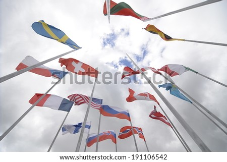 MINSK, BELARUS - MAY 5: Flags of the participating countries near the Minsk Arena before the IIHF World Championship on May 5, 2014 in Minsk, Belarus.