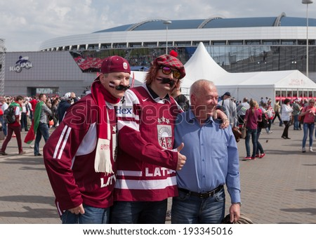 MINSK, BELARUS - May 17, 2014: ICE HOCKEY WORLD CHAMPIONSHIP, MINSK-ARENA, The hockey fans from Latvia with a moustache in the uniform of a national team of Latvia - stock photo