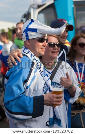 MINSK, BELARUS - May 18, 2014: ICE HOCKEY WORLD CHAMPIONSHIP, MINSK-ARENA, The hockey fans from Finland in national team uniform and hats - stock photo