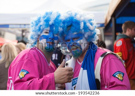 MINSK, BELARUS - May 18, 2014: ICE HOCKEY WORLD CHAMPIONSHIP, MINSK-ARENA, The hockey fans from Finland in funny costumes and wigs - stock photo