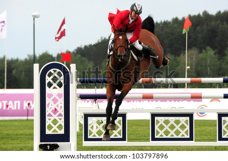 MINSK, BELARUS - MAY 27: Lukasz Wasilewski from Poland (2 place in (CSIO2*-W 160 ??) competes in final during KAP JUMPING HORSE SHOW 2012 on May 27, 2012 in Minsk, Belarus. - stock photo