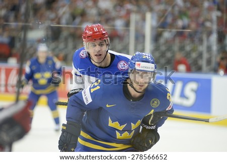 MINSK, BELARUS - MAY 24: MALKIN Yevgeni(L) of Russia looks on during 2014 IIHF World Ice Hockey Championship match at Minsk Arena on May 24, 2014 in Minsk, Belarus. - stock photo
