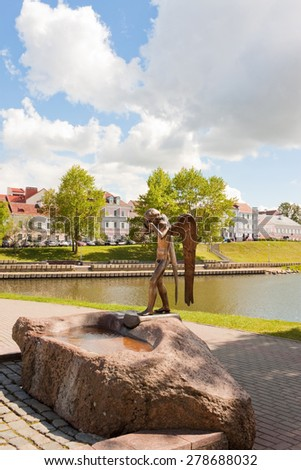 Minsk, Belarus - May 15, 2015: Sculpture of crying angel on the Isle of Tears, a memorial to soviet soldiers who died in the war with Afghanistan in 1979-1989. - stock photo