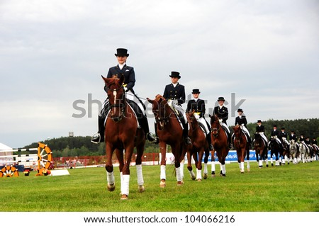 MINSK, BELARUS - MAY 27: Unidentified girls (School of Olympic Reserve) participating in show of equestrian dressage during KAP JUMPING HORSE SHOW 2012 on May 27, 2012 in Minsk, Belarus. - stock photo