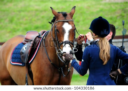MINSK, BELARUS - MAY 27: Unidentified sportsmen is preparing for the start during KAP JUMPING HORSE SHOW 2012 on May 27, 2012 in Minsk, Belarus.