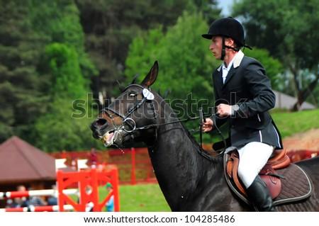 MINSK, BELARUS - MAY 27: Yahor MOROTSKI (horse WACANTOS) from Belarus during KAP JUMPING HORSE SHOW 2012 on May 27, 2012 in Minsk, Belarus. - stock photo