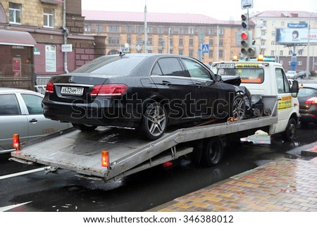 MINSK, BELARUS - NOVEMBER 19, 2015: crashed Mercedes from Moscow is towed in Minsk