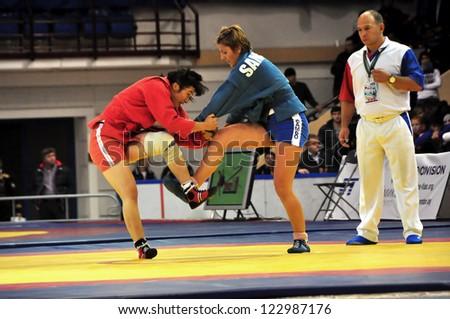 MINSK, BELARUS - NOVEMBER 10: Haytybaeva (red(TKM) hooking Ivanova(BUL) during SAMBO (Wrestling) WORLDCh-2012 on November 10, 2012 in Minsk, Belarus. - stock photo