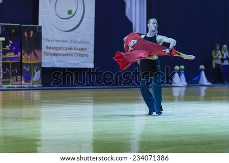 Minsk-Belarus,October 4,2014:Andrey Zaycev and Elizaveta Cherevichnaya (Russia) perform Latin-American Program Performance on World Open Minsk-2014 WDSF Championship in October 4,2014 in Minsk,Belarus - stock photo