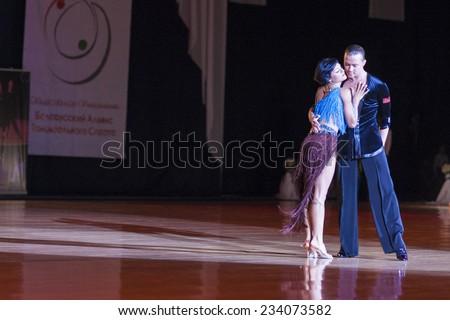 Minsk-Belarus, October 4,2014:Andrey Zaycev and Elizaveta Cherevichnaya(Russia) perform Latin-American Program Performance on World Open Minsk-2014 WDSF Championship in October 4,2014 in Minsk,Belarus - stock photo
