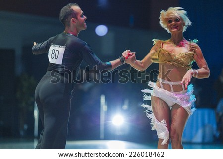 Minsk-Belarus, October 18, 2014: Unidentified Dance Couple Performs Adult Latin-American Program on on IDSA World Open Championship 2014 in October 18, 2014, in Minsk, Republic of Belarus