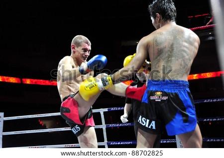 MINSK, BELARUS-SEPT. 12: Andrej Kulebin of Belarus kicking VS Sudsakorn Klinmi of Asia (right) in final fight of BIG8 MUAY-THAY CHAMP in Minsk, Belarus on September 12, 2010 - stock photo
