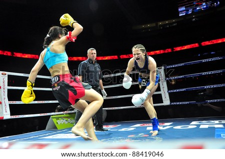 MINSK, BELARUS-SEPT. 12: Joanna JEDRZJCYK of HOLLAND (left) vs Alla IVASHKEVICH of BELARUS at BIG8 MUAY-THAY CHAMP in Minsk, Belarus on September 12, 2010