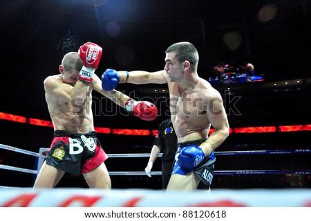 MINSK, BELARUS-SEPTEMBER 12:Andrej Kulebin(left) BelarusVS Taylor Harvey(right) Australia fight at the BIG8 MUAY-THAY CHAMP in Minsk, Belarus on September 12, 2010 - stock photo