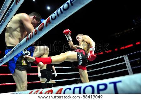 MINSK, BELARUS-SEPTEMBER 12:Andrej Kulebin(R) of Belarus VS Taylor Harvey of Australia fight at BIG8 MUAY-THAY CHAMP in Minsk, Belarus on September 12, 2010 - stock photo