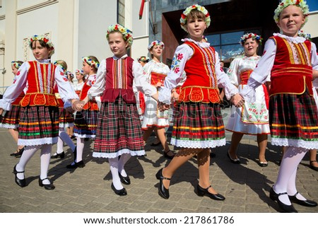 MINSK, BELARUS - SEPTEMBER 13: Belarusian people celebrate the City day of Minsk on central square of the city on 13 of September 2014, Republic of Belarus - stock photo