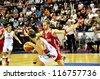 MINSK, BELARUS SEPTEMBER 2: Unidentified basketball player (Turkey (red) in defense during European Championship qualifying match (Belarus-Turkey) on September 2, 2012 in Minsk, Belarus. - stock photo