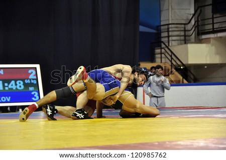 MINSK, BELARUS - SEPTEMBER 16: Unidentified wrestlers fighting in the pit during Grand Prix for the prizes A.Medved in freestyle wrestling on September 16, 2012 in Minsk, Belarus. - stock photo