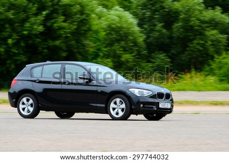 MINSK - JULY 2015: new BMW 1-series 2015 drives along the road during the test drive event for automotive journalists from Minsk
