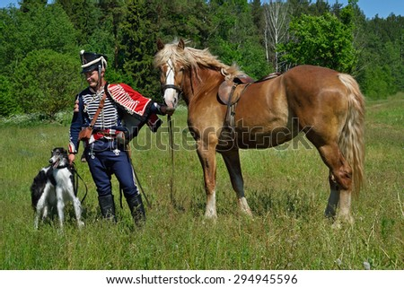 MINSK REGION, BELARUS - JUNE 6: Russian lancer taking part in the historical reconstruction of fight in napoleonic war between Russian and French armies in 1812. June 6, 2015, Mejdurechye, Belarus - stock photo
