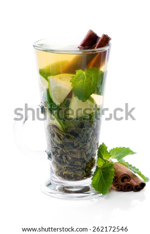 Mint and lime iced green tea and  cinnamon. - stock photo