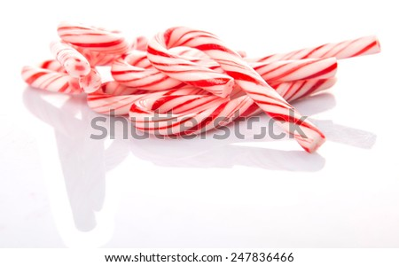 Mint Christmas colors candy cane over white background