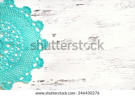 Mint Crochet doily border over shabby chic wood - stock photo