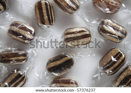 mint humbugs on white background - stock photo