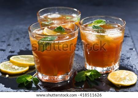 mint iced tea in glasses, horizontal - stock photo