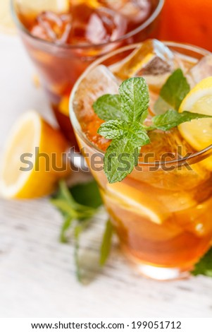 Mint leaf and lime slice on the top of iced tea - stock photo