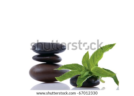 mint leaf and Stack of stones isolated on white background