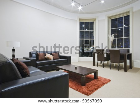mint living room with large bay window - stock photo