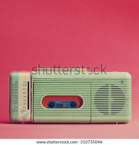 Mint retro radio over red - stock photo