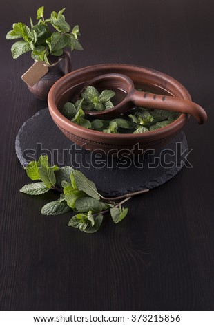 Mint tea with fresh mint leaves. Herb infusion in a ceramic bowl