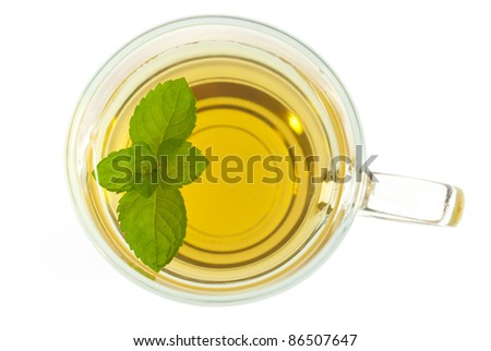 mint tea with leaves directly above, isolated on white - stock photo
