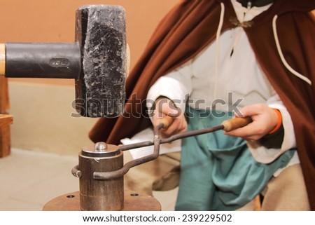 minting coins with old medieval methods - stock photo