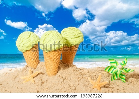 Minty flavor icecreams with pinwheel on summer beach - stock photo
