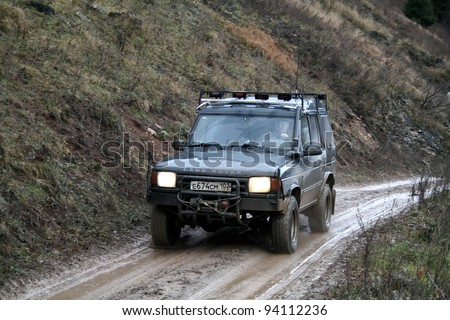 """MINYAR, RUSSIA - OCTOBER 31: Off-road vehicle Land Rover Discovery takes part at the annual trophy challenge """"Samhain"""" on October 31, 2009 in Minyar, Chelyabinsk region, Russia. - stock photo"""