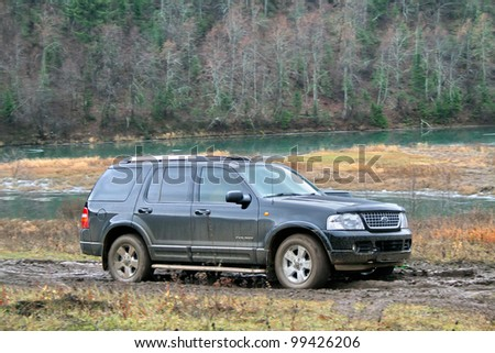 """MINYAR, RUSSIA - OCTOBER 31: Sport-utility vehicle Ford Explorer takes part at the annual trophy challenge """"Samhain"""" on October 31, 2009 in Minyar, Chelyabinsk region, Russia. - stock photo"""