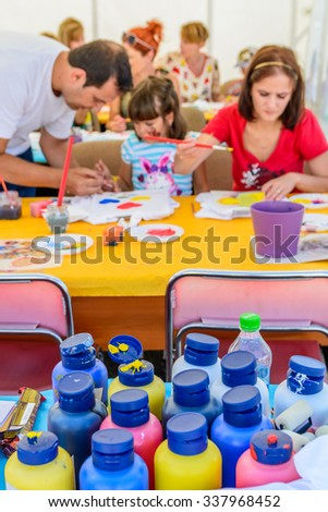 MIOVENI, ROMANIA - October 10: Hand Made demonstration in Mioveni, Romania on October 10, 2015. A group of children making crafts out of colored paper - stock photo