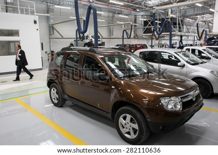 Mioveni, Romania - September 15, 2010: Color picture of Dacia cars on the assembly line of the Dacia Renault factory. - stock photo