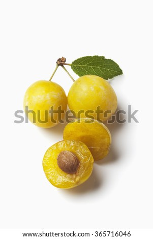 Mirabelles on white background