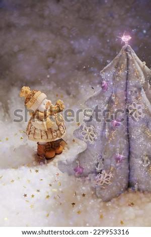 Miracle shiny Christmas tree and funny snowman - stock photo